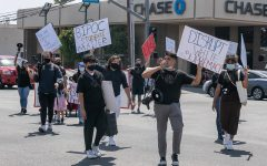 Colored Minds Inc. protesters block the intersection of Reseda Boulevard and Nordhoff Street in Northridge, Calif., on Saturday, April 17, 2021, to bring attention to their cause.