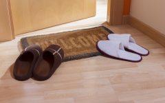 Welcome home doormat with open door and 2 pairs of slippers