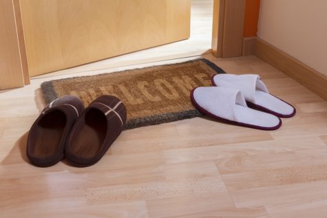 Welcome home doormat with open door and 2 pairs of slippers