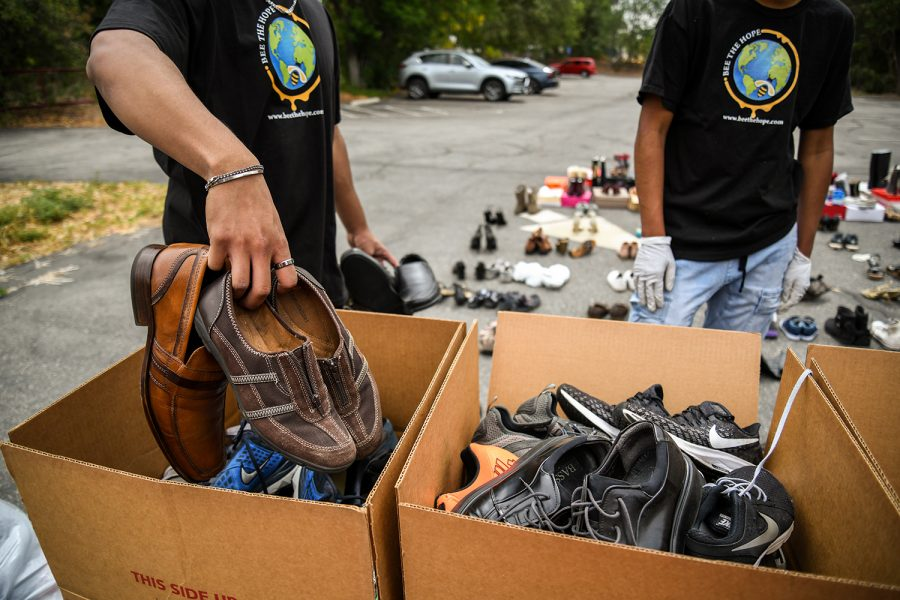 Rajanno Rahim, a member of the nonprofit organization Bee The Hope, puts a pair of shoes in a donation box during the organizations shoe donation event for the unhoused community at the Congregational Church of Northridge in Northridge, Calif., on April 24, 2021.
