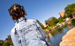 Quinten's daughter Ashanti Thomas wears a denim jacket that has the phrases