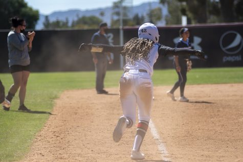 Jaymi Steward runs toward her teammates to celebrate their win against the University of San Diego at the Matador Diamond in Northridge, Calif. on Wednesday, April 28, 2021.