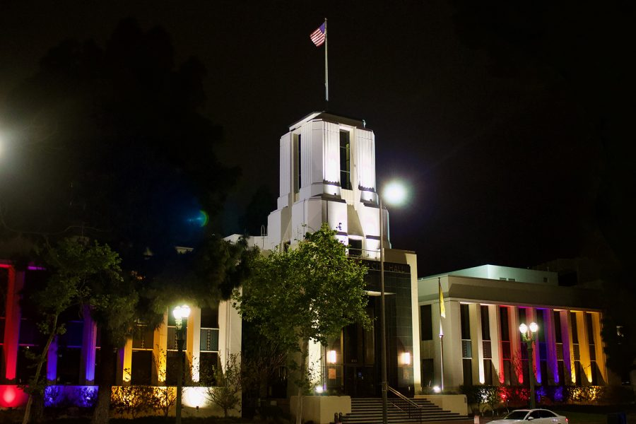 Glendale City Hall glows with the colors of the Armenian Flag — red, purple and gold — in Glendale, Calif. on April 23, 2021.