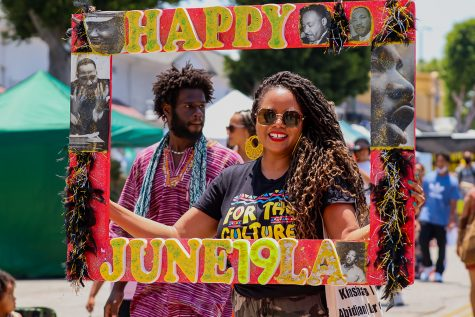Kai Lawson poses for a photo for the Juneteenth celebration at the Leimert Park Rising event in Los Angeles, Calif. on Saturday, June 19, 2021.