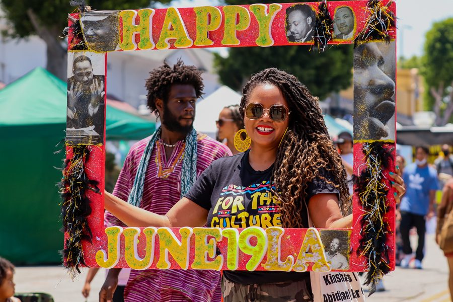 Kai+Lawson+poses+for+a+photo+for+the+Juneteenth+celebration+at+the+Leimert+Park+Rising+event+in+Los+Angeles%2C+Calif.+on+Saturday%2C+June+19%2C+2021.