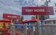 Signs lined up along the Hope of the Valley Rescue Mission Tiny Home homeless shelter in North Hollywood, Calif., on Tuesday, Feb. 9, 2021.