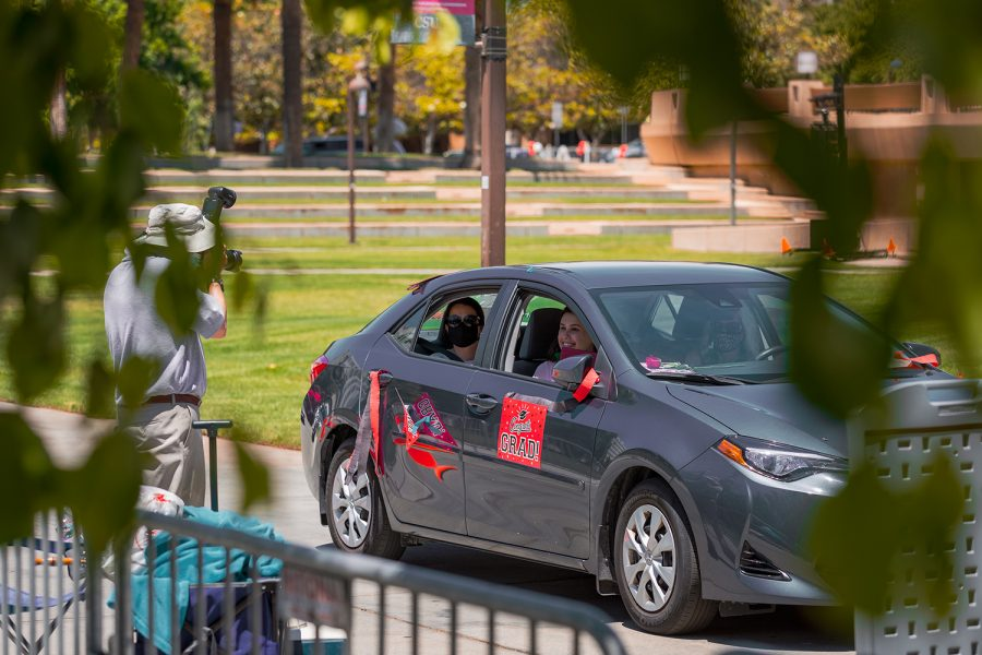 The CSUN Grad Parade route concluded with an opportunity to take an in-vehicle photo in front of the University Library on Matador Walk.