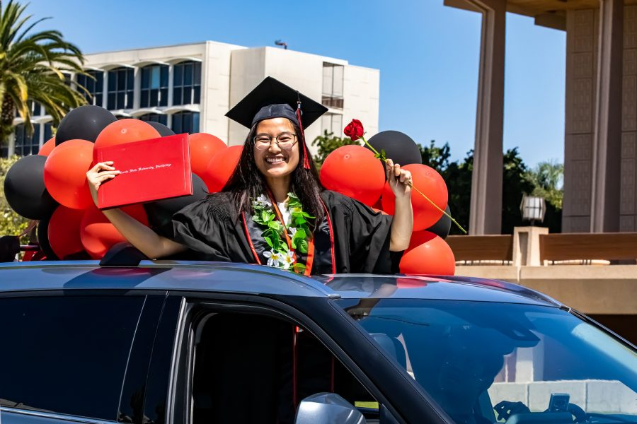 CSUN graduates drive through the parade route and received their diploma holders, roses and other various gifts.