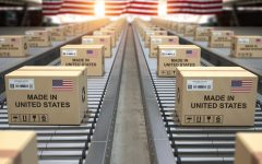 Cardboard boxes with text made in USA and american flag on roller conveyor