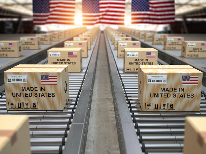 Cardboard+boxes+with+text+made+in+USA+and+american+flag+on+roller+conveyor