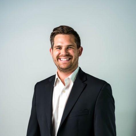 smiling man in a dark suit