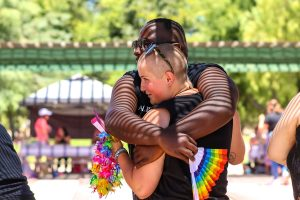 Richard Grey embraces his friend Emma at Simi Valley Pride in Simi Valley, Calif. on June 26, 2021.