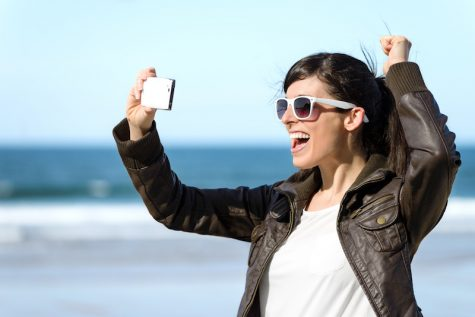 Woman taking photo with phone