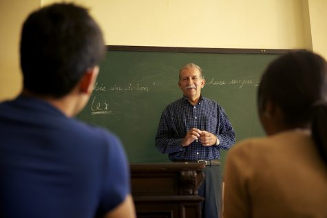 professor talking to students during lesson