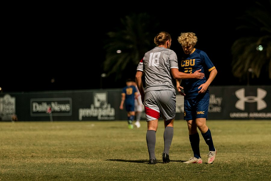 Maxamillion Yanakaev, left, apologizes to Emiel Deconinck, right, after fouling him hard in the second half of their match at Performance Field in Northridge, Calif., on Friday, Sept. 17, 2021.