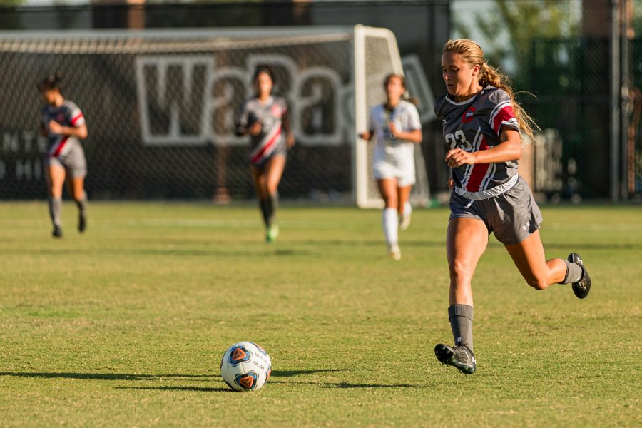 Brooke Mobeck, 23, pushes the ball up the field during their match against UCSD at the Performance Field in Northridge, Calif. on Wednesday, Sept. 16, 2021.