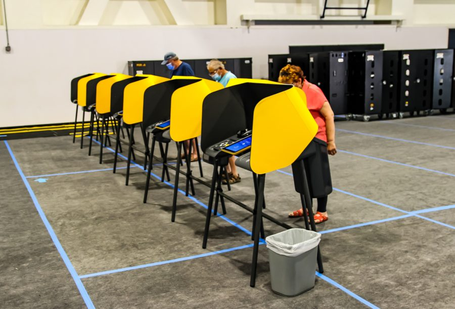 Voters cast their ballots at the CSUN voting center in Redwood Hall in Northridge, Calif., on Tuesday, Sept. 14, 2021.