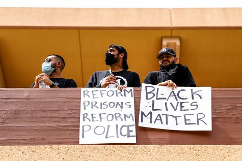 CSUN students hold signs in support of the Black Lives Matter protest at CSUN hosted by Northridge BLM on June 2, 2020.