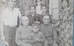 Ofelyas great grandmother Hayastan (left of first row) and great grandfather Vagharshak (right of first row), along with her grandfather Albert (boy in the back row holding the dog).