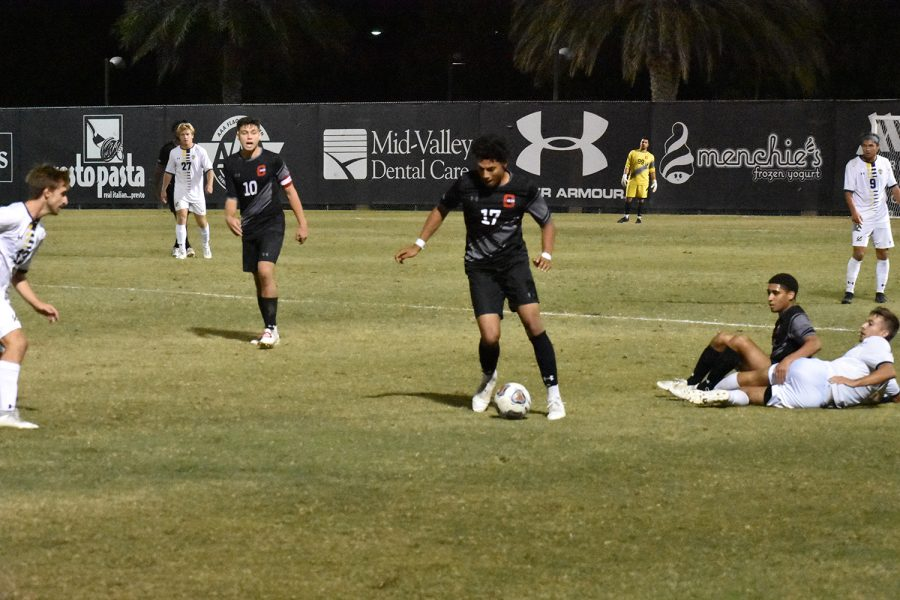 CSUN redshirt freshman Marcos Delgado, 17, moves the ball downfield against UCSD in Northridge, Calif., on Saturday, Oct. 9, 2021.