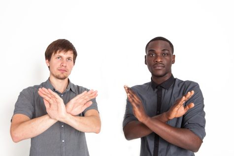 two men with their arms crossed in an X position