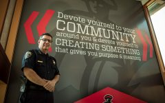 Alfredo Fernandez, the interim Chief of Police at CSUN, stands in front of a mural in the Police Services building. The words on the mural say Devote yourself to your community around you & devote yourself to creating something that give you purpose & meaning.