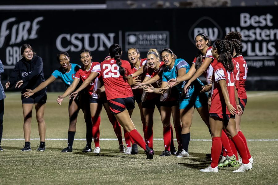 CSUN womens soccer team cheer each other on before the game against UC Riverside in Northridge, Calif. on Thursday, Oct. 14, 2021.