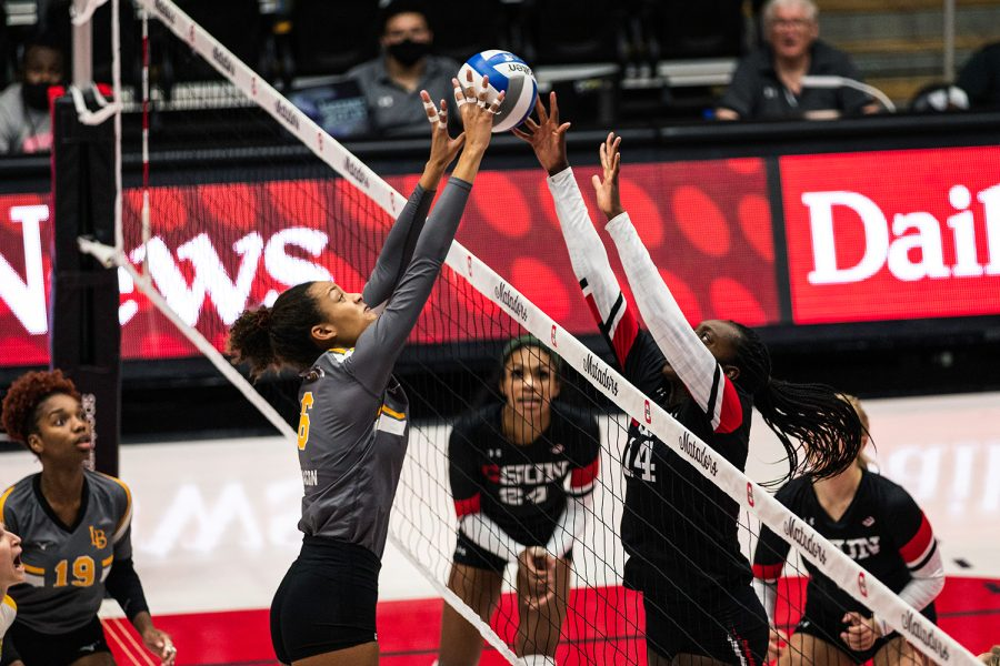 Kameron Bacon, left, and Taylor Hunter contest each other at the net during the first set of the match between CSUN and Long Beach State at the Matadome in Northridge, Calif., on Saturday, Oct. 9, 2021. CSUN lost to Long Beach State in four sets.