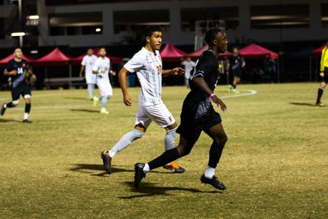 Jamar Ricketts, right, sprints after the ball during the game against California State University, Fullerton in Northridge, Calif. on Wednesday, Oct. 20, 2021.