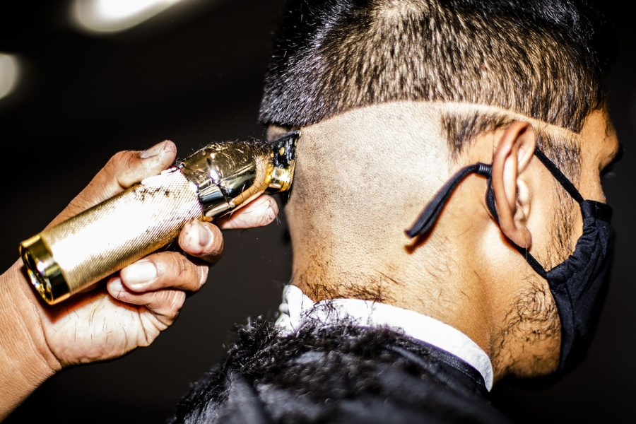 Matt Bautista works on a customers haircut at the Standard Barbershop in Northridge, Calif., on Saturday, Oct. 9, 2021.