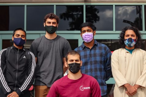 MSA President Redhawam Ahmed (extreme left) and Muslim Student Association members Zachary Gulshad, Azmi Shatela (front), Anaz Mohammed and Abdullah Tokhi stand outside of the East Conference Center at CSUN to pose for a picture.