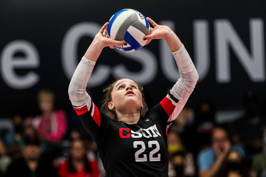 Carisa Barron, 22, sets the ball during the third set of the match against Long Beach State at the Matadome in Northridge, Calif., on Saturday, Oct. 9, 2021.